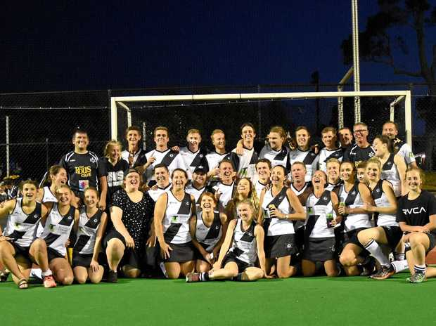 RELIEF SHOWS: Northern Star men and women's A-grade hockey teams celebrate after winning grand finals on Saturday.