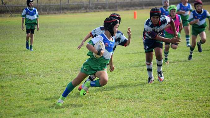 Under 9 Brahmans player Fedor Roganov made some ground against Mackay Brothers in the Paul Bowman Challenge Grand Final.