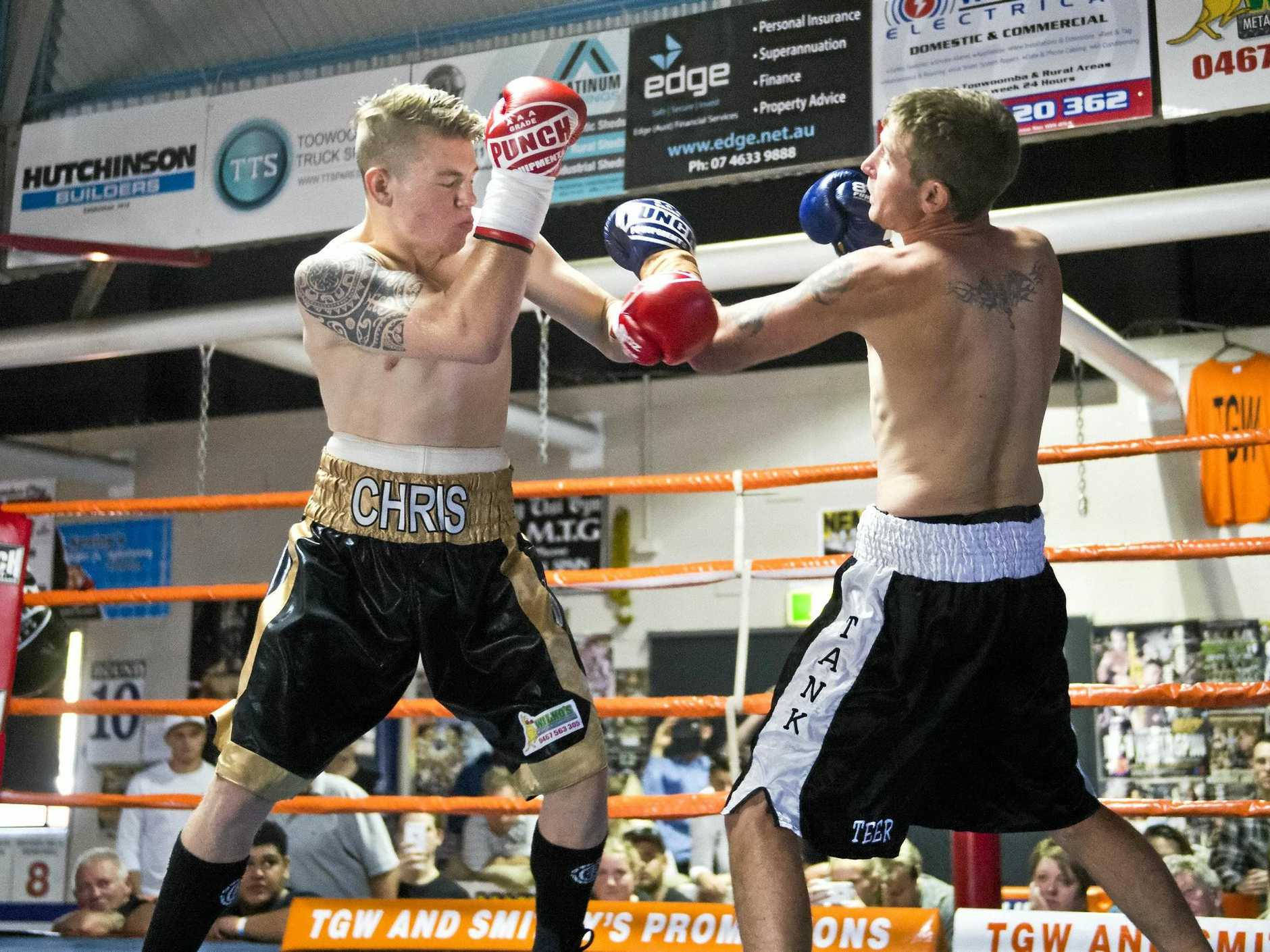 RING RUMBLE: Chris Brackin and Kyle Teer fight during the pro boxing bouts at Smithy's Gym.
