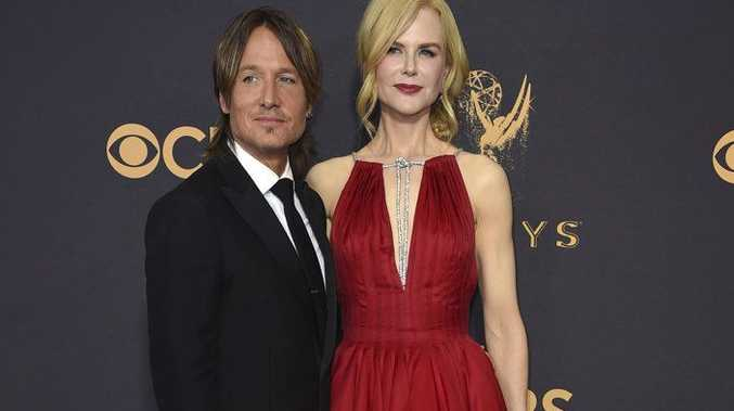 Keith Urban, left, and Nicole Kidman arrive at the 69th Primetime Emmy Awards in Los Angeles.