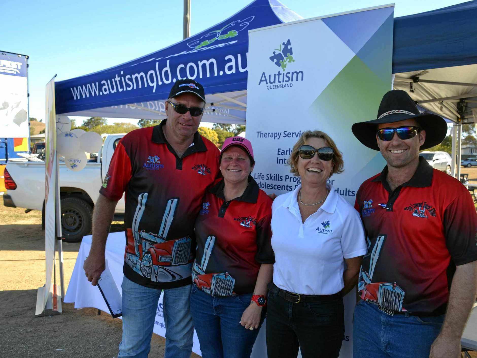 Lowood Truck Show's organisers Rob and Kassie Liston, Craig Severn with Adrienne Costin from Autism Queensland .
