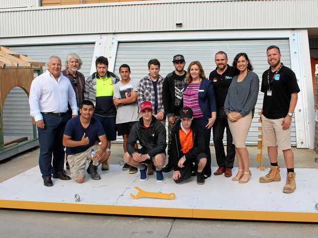 CEMENTING PARTNERSHIP:  TAFE students with members of the Nambour Alliance and project organisers.