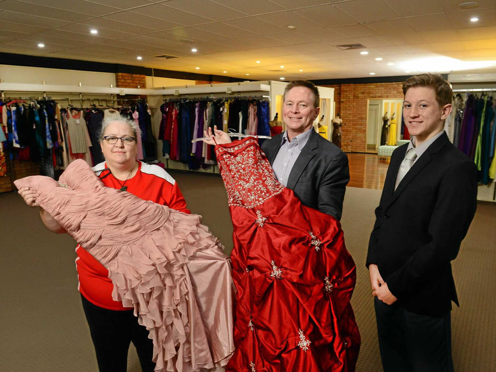 MAGIC WAND: Fairy God Mother Project founder Sam Harrison, Hearts and Minds Foundation director Grant Wallace and Konrad Wallace check out some of the donated formal wear.