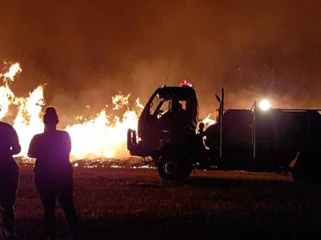 FIRE: People watched on as the grass fire burned. Photo by Steven Shields.