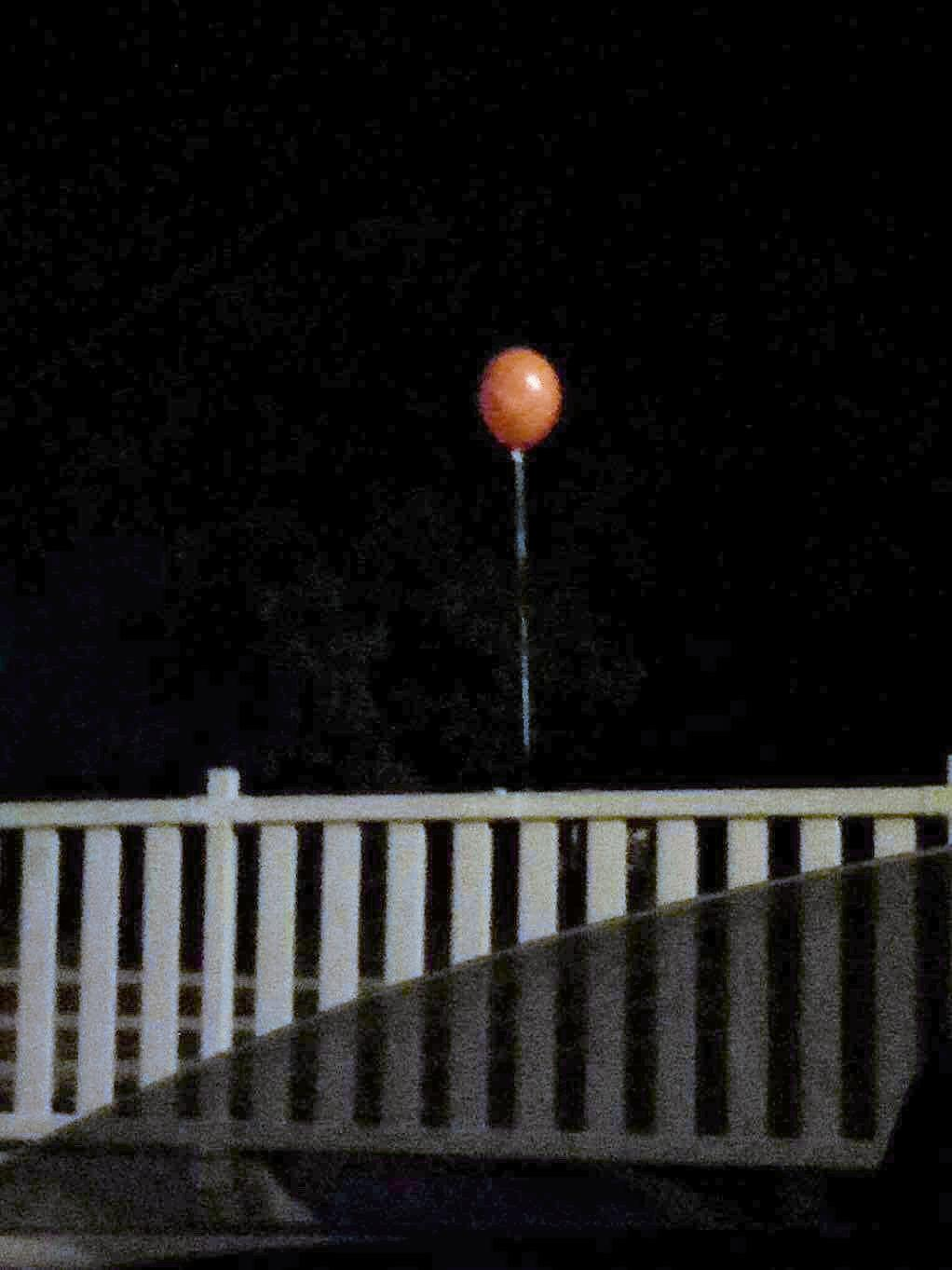 STUFF OF NIGHTMARES: Shayler McRae submitted this photo to the NewsMail of a red balloon on a drain rail in Bundaberg.