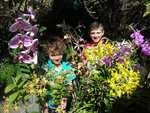 BURSTING WITH COLOUR: Bailey and Lucas Ehsman admiring some locally grown Orchids.