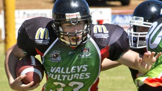 IN ACTION: Toowoomba Valleys Vultures colts player Matthew Perrin tries to find space at Herb Steinohrt Oval.
