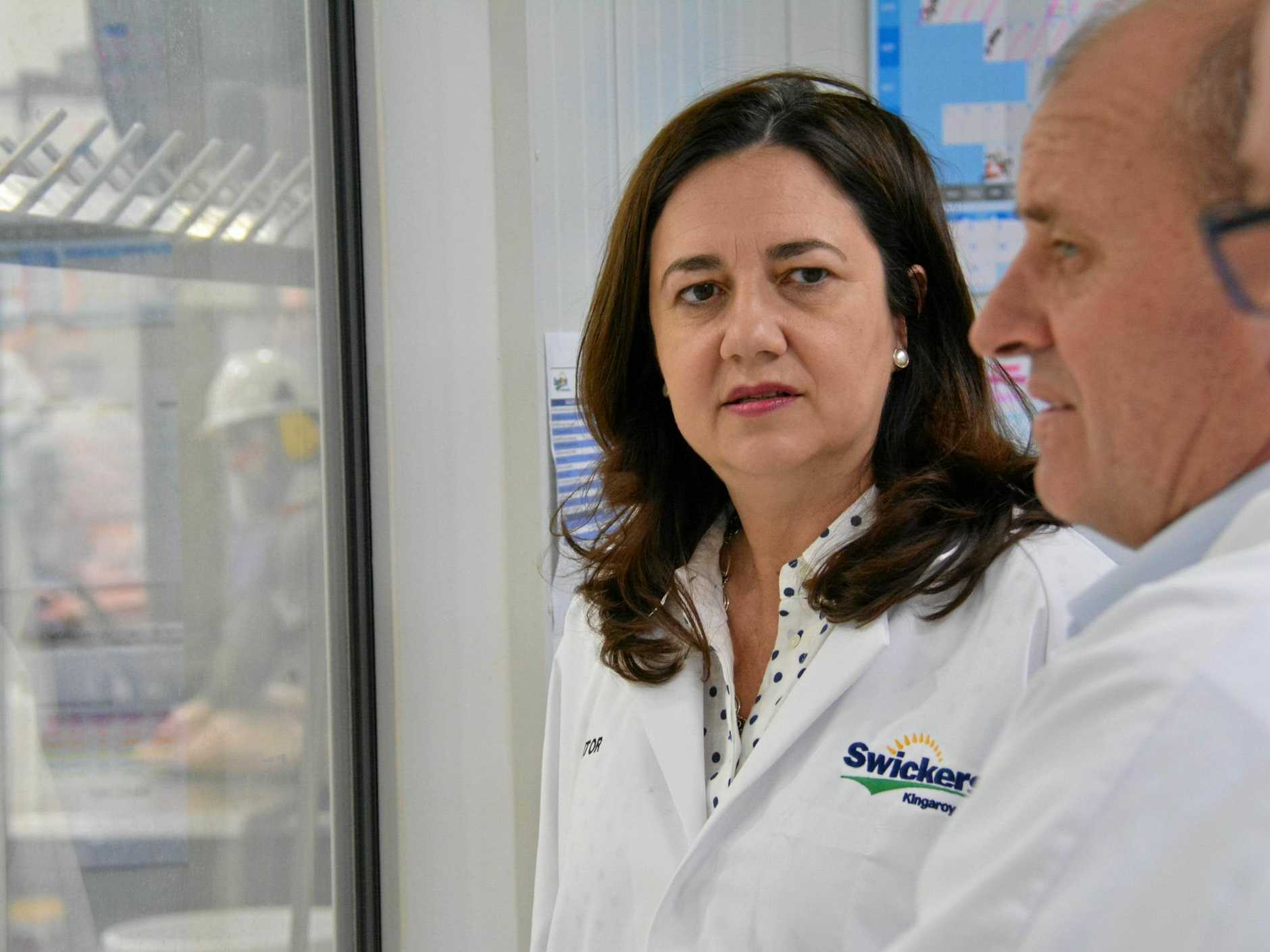 Premier Annastacia Palaszczuk and General Manager of Operations at Swickers Linchon Hawks inspect the temporary boning room at Swickers Bacon Factory Kingaroy, September 18, 2017