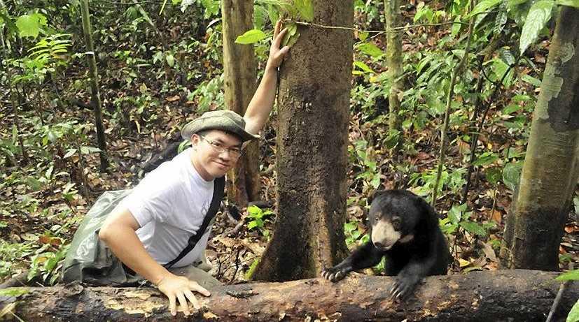 WORTH SAVING: Wong Siew Te with a sun bear in Malaysia.