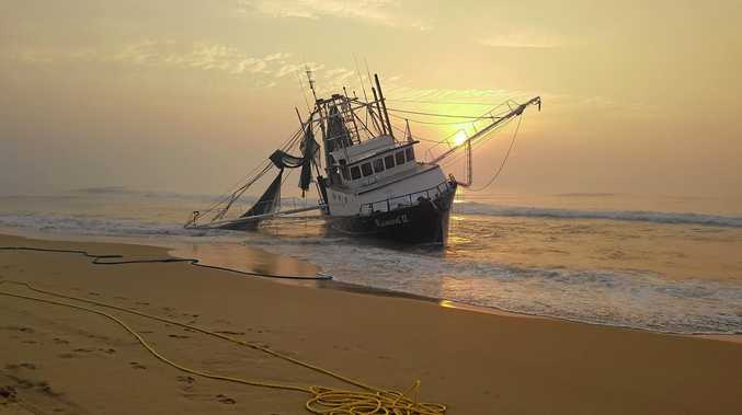 STRANDED: Authorities will attempt to refloat a trawler beached on Fraser Island after unsuccessful attempts over the weekend.