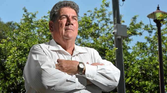 Somerset Council Mayor Graeme Lehmann is looking forward to installing 12 new security cameras in Lowood like the ones behind him in this photograph. Photo: Rob Williams / The Queensland Times