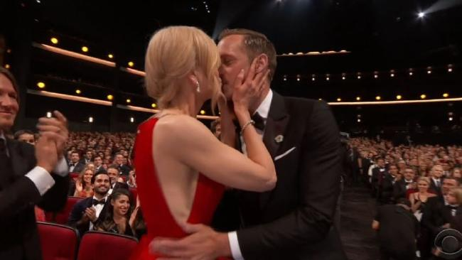 A co-star kiss. Don't try this in your office, folks.