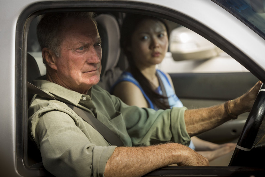 Bryan Brown and Jenny Wu in a scene from the movie Australia Day.