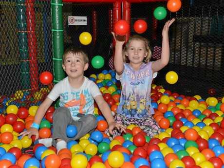 BALL PIT: Max Parker and Jaz Martin having fun at Bundy Bowl and Leisure.