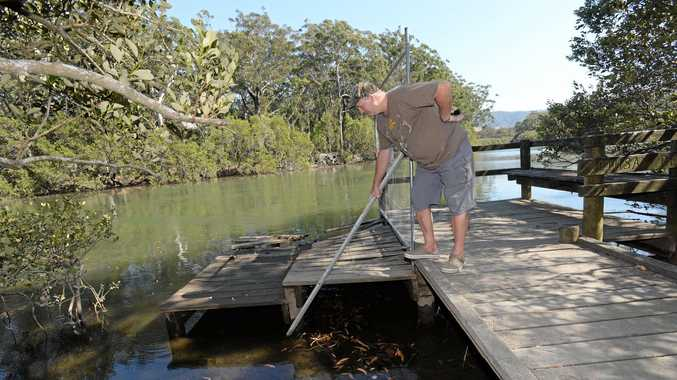Chris Horton inspects what's left of the timber jetty and looks in vain for missing gear.
