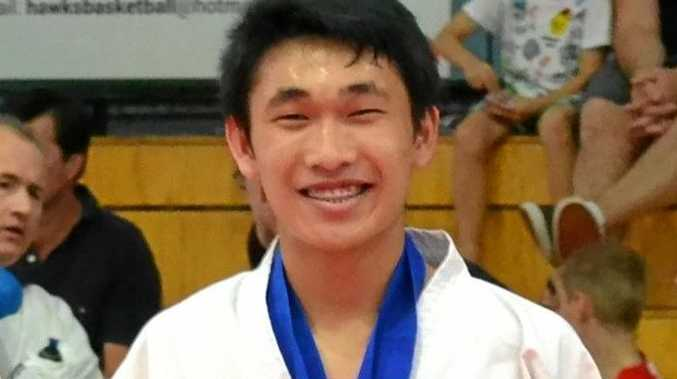 STRONG EVENT: Toowoomba's Israel Escano with a medal at the GKR Karate State Championships.
