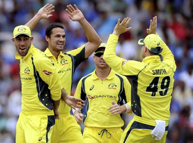 Australia cricket player Nathan Coulter-Nile (second from left) celebrates after Ajinkya Rahane's wicket during their first one-day international.