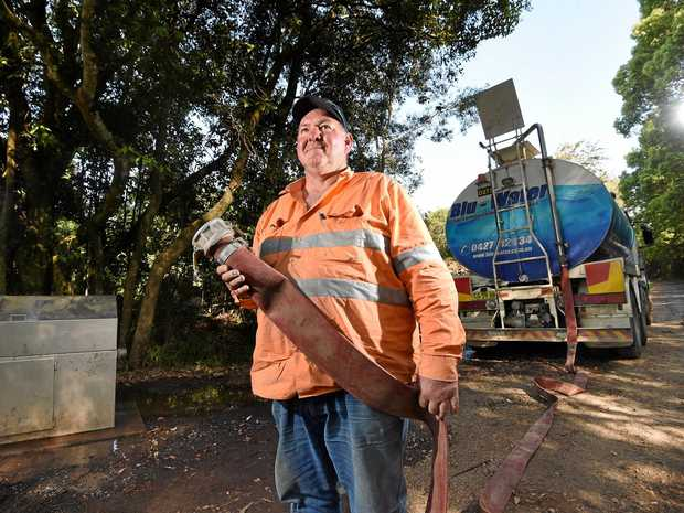 HOME AND HOSED: Blu-Water employee Rowan Weir collects more water for his deliveries around the Northern Rivers after residents wait in dire need of rain to fill their tanks.