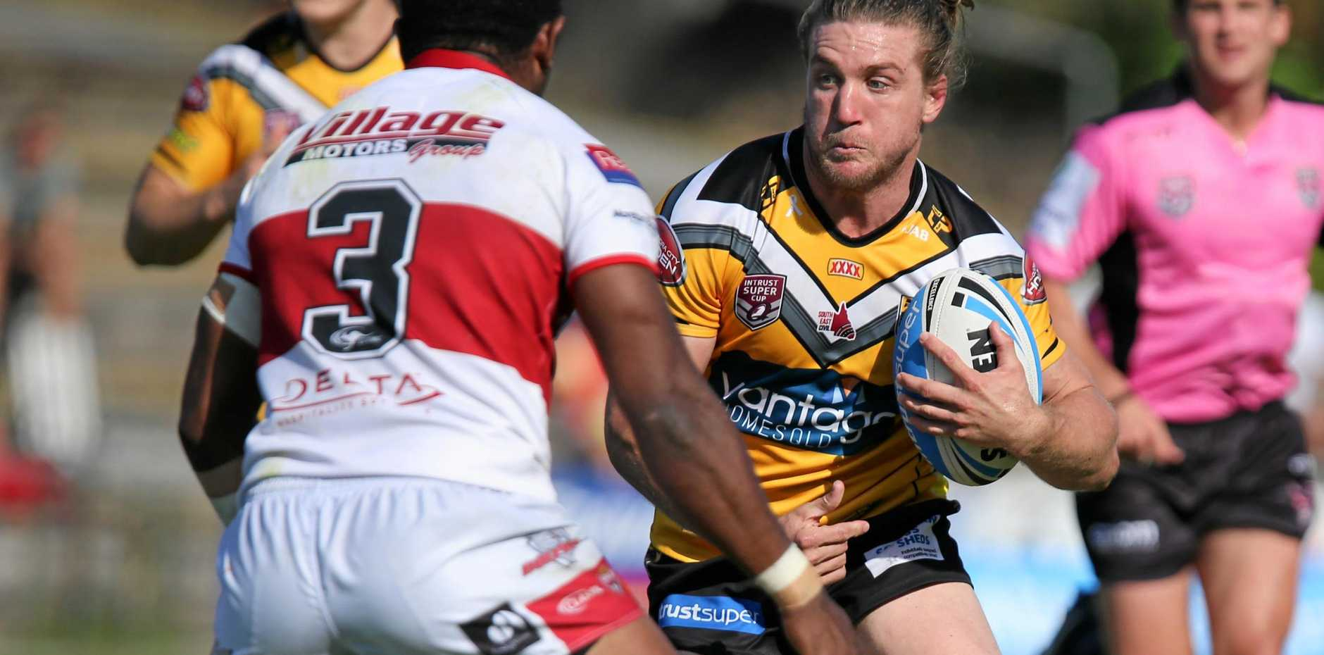 STRONG: Sunshine Coast Falcons player Jon Grieve in action against the Redcliffe Dolphins. PHOTO: Level Eleven Photography, Ritchie Duce