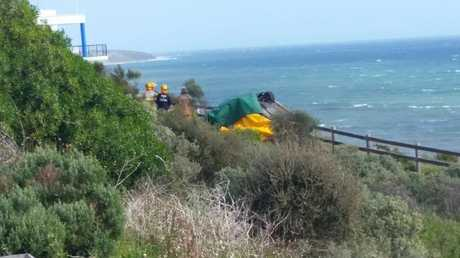 A car has gone off a cliff in Adelaide.
