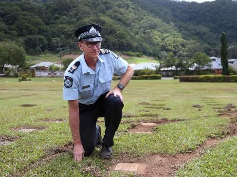 Senior Sergeant Jason Smith inspects the scene at Forest View Cemetery where someone has driven over a heap of graves, including children's graves. PICTURE: STEWART McLEAN