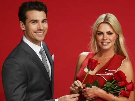 Matty J hands over the rose baton to The Bachelorette Sophie Monk. Picture: Justin Lloyd.