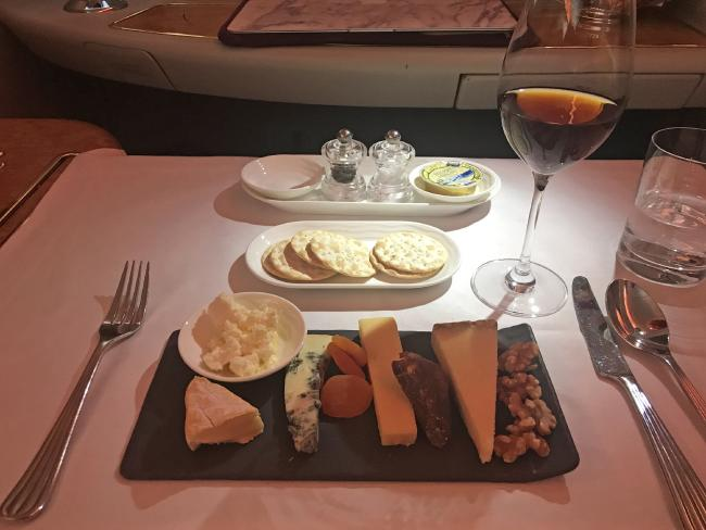 The cheese platter and exclusive port served in First Class. Picture: Celeste Mitchell