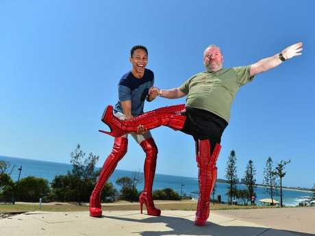 Having fun in high heels: Callum Francis steadies Phil Dillon during his walking lesson.