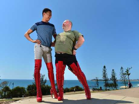 Philip Dillon gets a few tips from actor Callum Francis of Kinky Boots at Alexandra Headland.