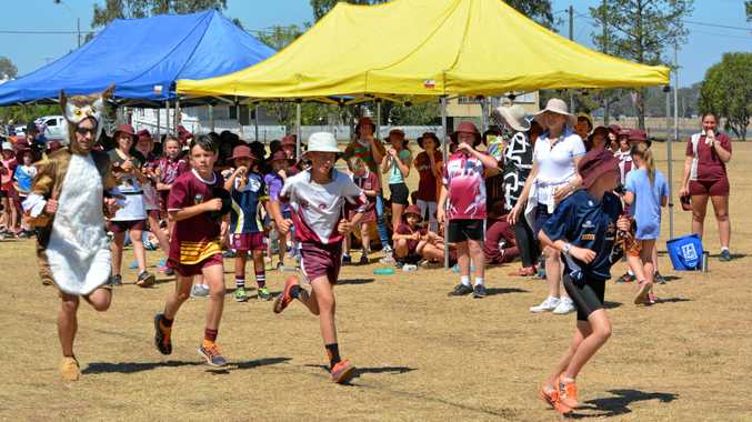 CHASE IS ON: Local runner and Rosewood High School teacher Andrew Willey chases students at the Rosewood State School CUA fun run on Friday.