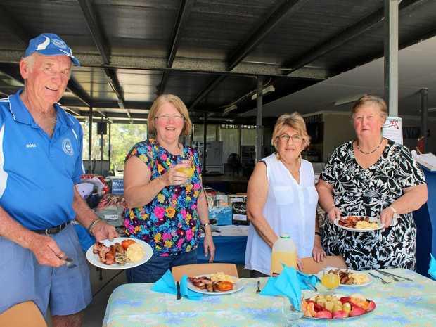 BRUNCH TIME: Ross Newton, Liz Taylor, Elaine Muczynski and Judy Newton prepare for their fifth fundraiser brunch.