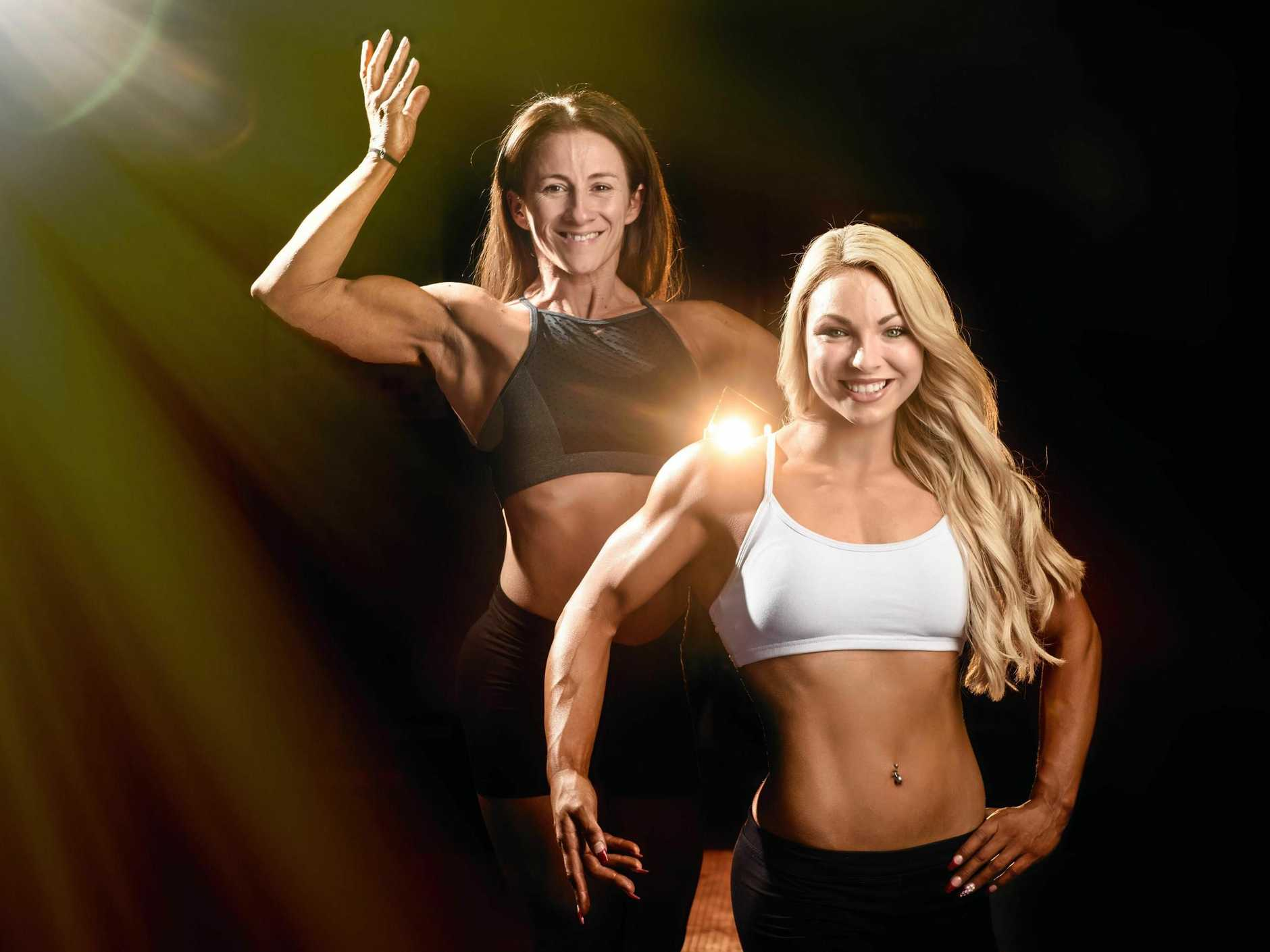 Dannielle Purnell and Bec Pateman show off their success from the Muscle Mania contest.