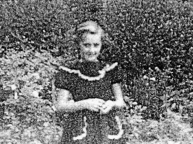 Little Judith Davidson (now Piercy) on her 9th birthday at Grafton Hospital in 1957, wearing her special dress.