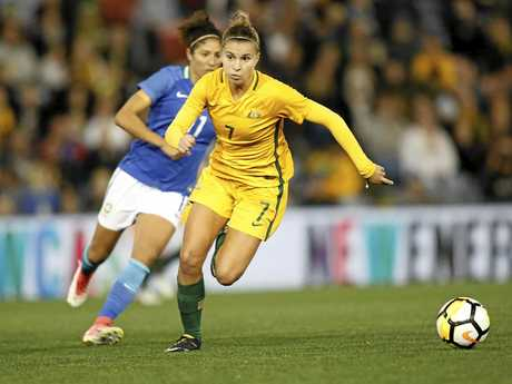 Steph Catley of the Matildas (right) looks for support