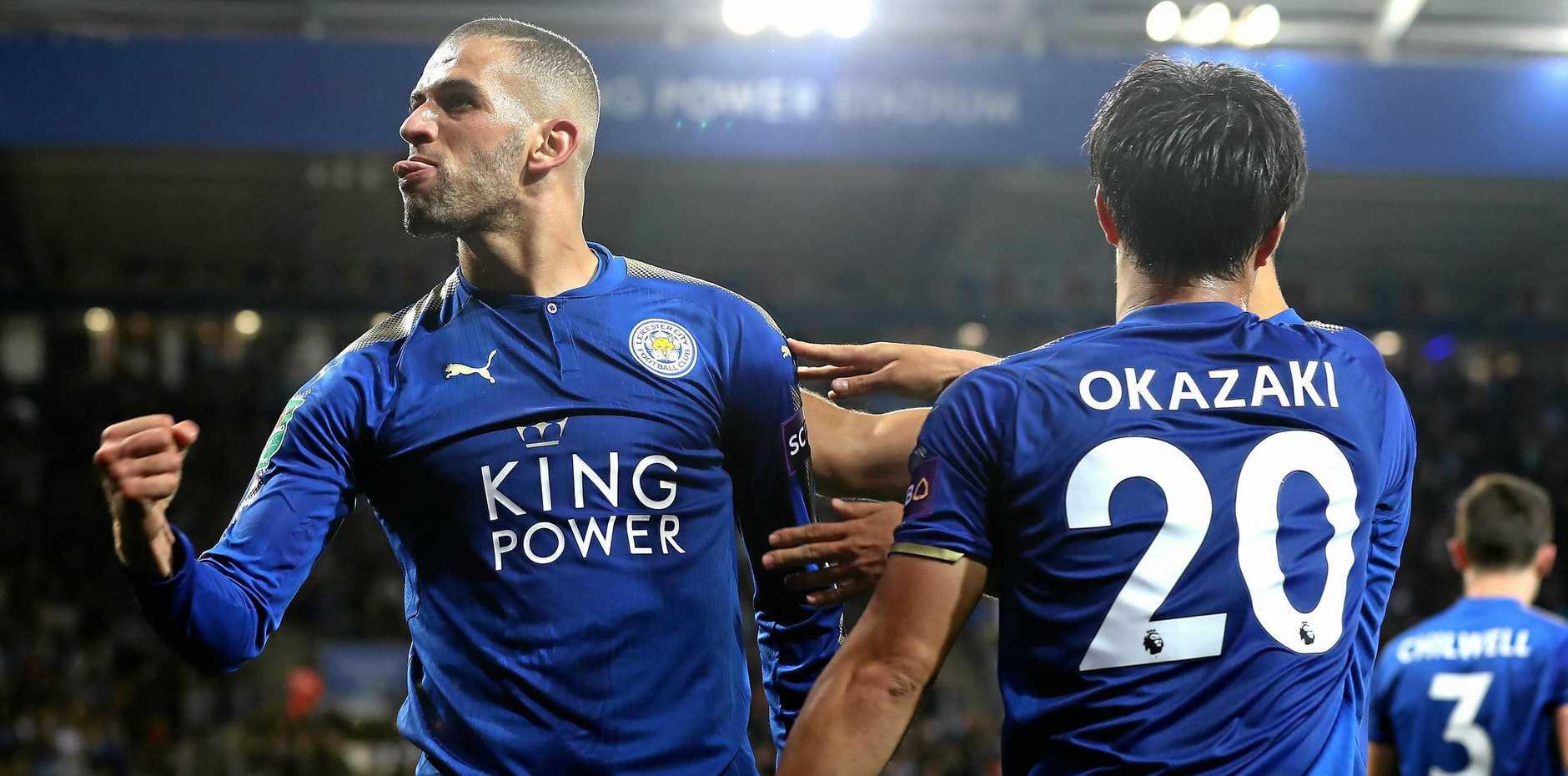 Islam Slimani of Leicester City celebrates scoring his side's second goal with Shinji Okazaki against Liverpool.