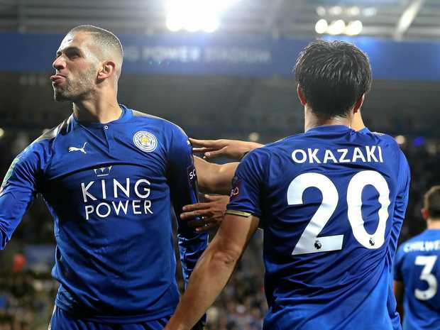 Islam Slimani of Leicester City celebrates scoring his side's second goal with Shinji Okazaki against Liverpool.