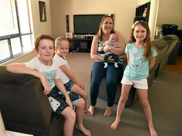 FAMILY TIME: Amy Slapp, holding Lochlan, with Declan, Olivia and Abigail take some time out at home meeting the newest addition to their family.