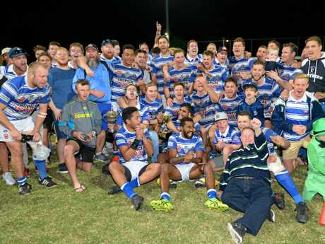 Coach Damien Seibold and the Brothers A-grade team celebrate their grand final win.