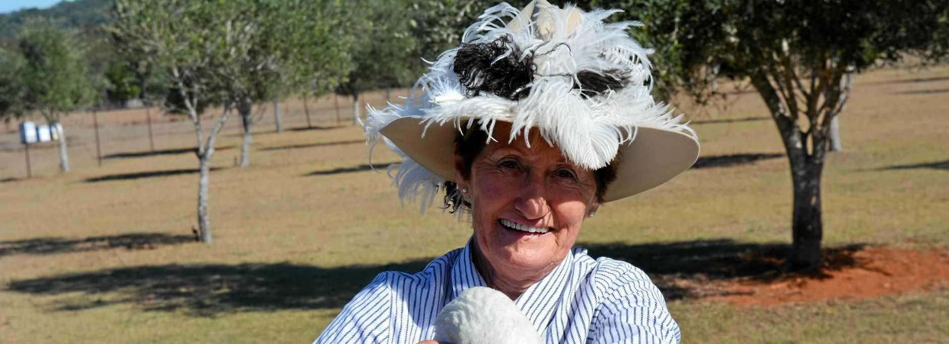 Brisbane Valley Ostrich and Fish Farm owner Patti Jaenke with 'Duck' the gander.
