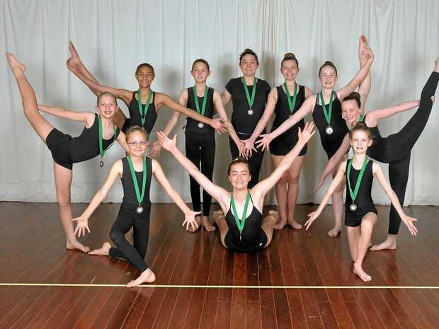 Fraser Coast Calisthenics Club's juniors team: Standing: Ruth, Triar, Paige, Jesse-May, Ava, Abbie, Grace. On the floor: Jade, Victoria, Sophie.