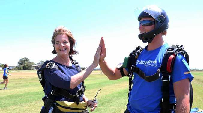 HIGH FIVE: Jennifer Whitney with skydive instructor Adam Hardacre land at Hamilton Plains.