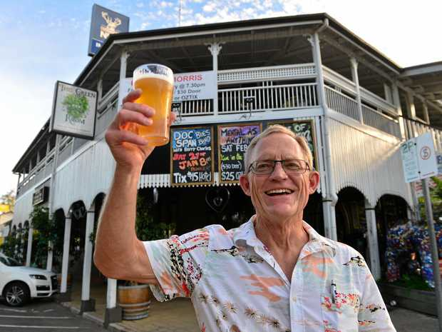 HERE'S CHEERS: Chuck Hahn at the Imperial Hotel in Eumundi, which is set to celebrate the town's history.