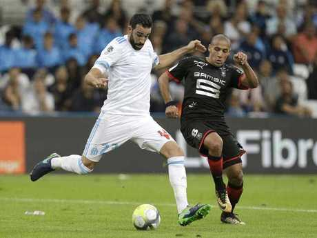 Marseille's defender Adil Rami, left, is a little jealous of Anderson's 'love' of Australian Julian Assange.
