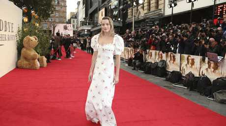 Actress Margot Robbie poses for photographers upon arrival at the World premiere of the film Goodbye Christopher Robin in London.