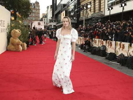 Image result for Australian actress Margot Robbie struggled with her dress at premiere of biopic, Goodbye Christopher Robin,