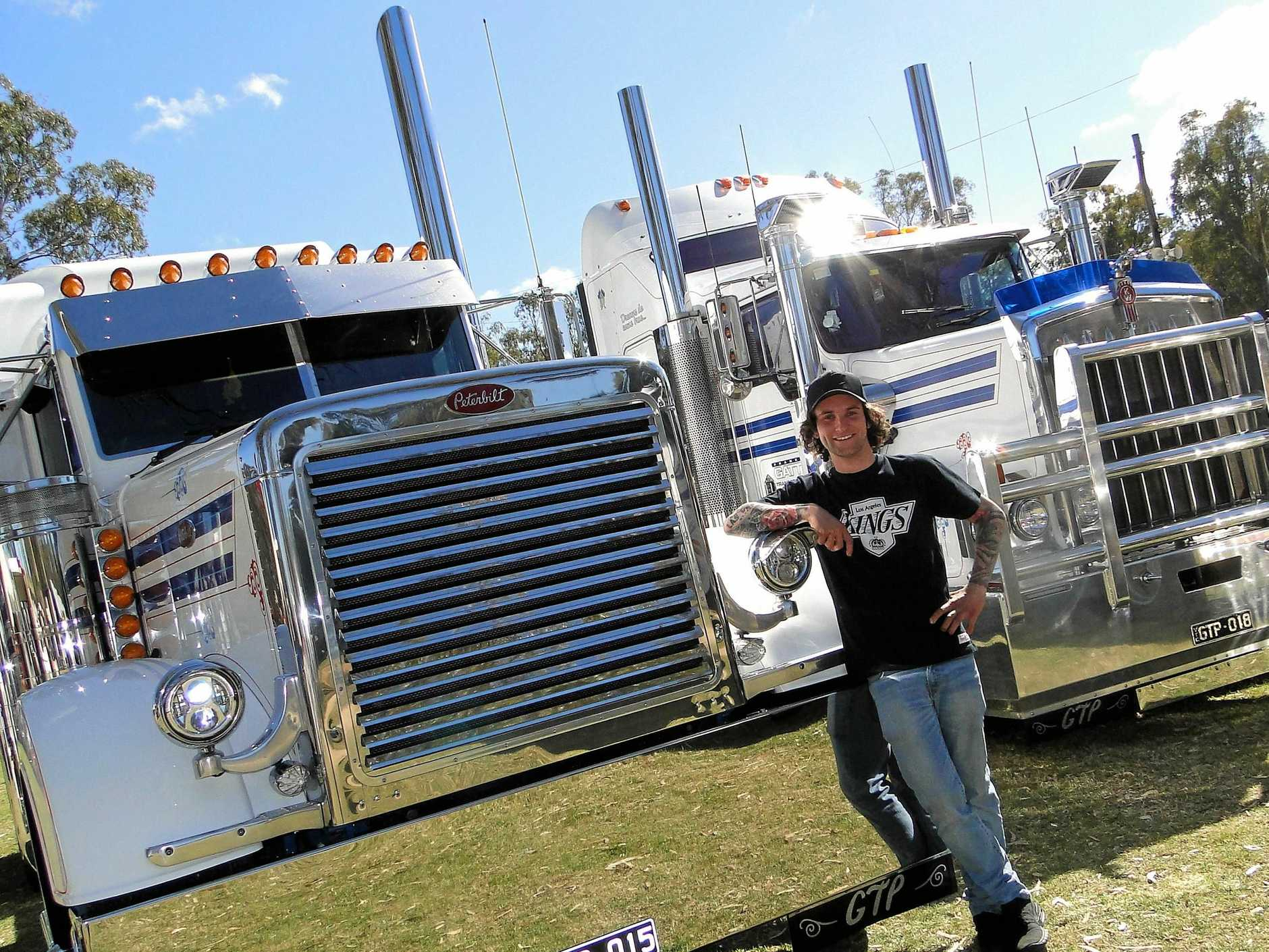 Geordy Gattuso standing proudly by his Peterbilt. An inspiring collection of heavy metal.