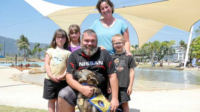 ON THE ROAD: Annika, Ziva, Paul, Kirstine and Cooper Roadly, with service dog Luna, in Airlie Beach on their Australian tour to raise awareness of mental health.