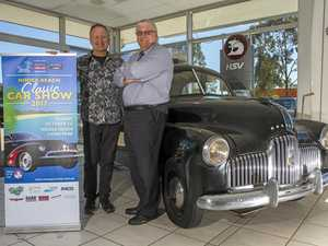 The 1952 FJ Holden with (left) Noel St.John Wood, Noosa Beach Classic Car Club, and Wayne Hoens, Bendigo Bank Tewantin.