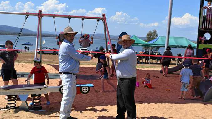 PLAY TIME: Mayor Nev Ferrier and director of council services John McDougall cutting the ribbon to officially open the playground.