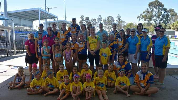 GOLDEN TOUCH: The Biloela Swim Club juniors, seniors and parents with Jess Schipper at the Biloela pool.
